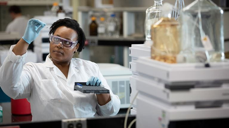 Scientist with vial