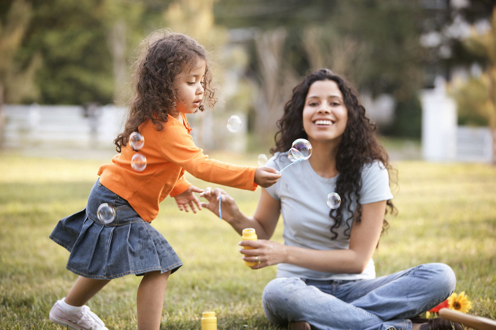 Female adult and child at a park